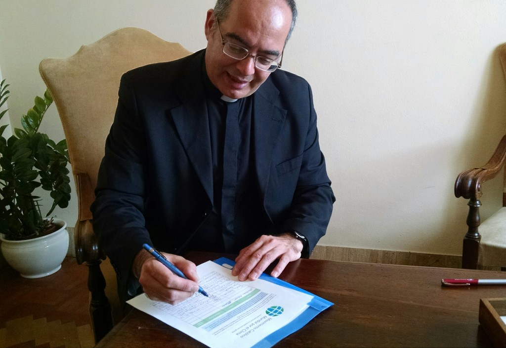 3 - Msgr Karcher signing on behalf of Pope Francis