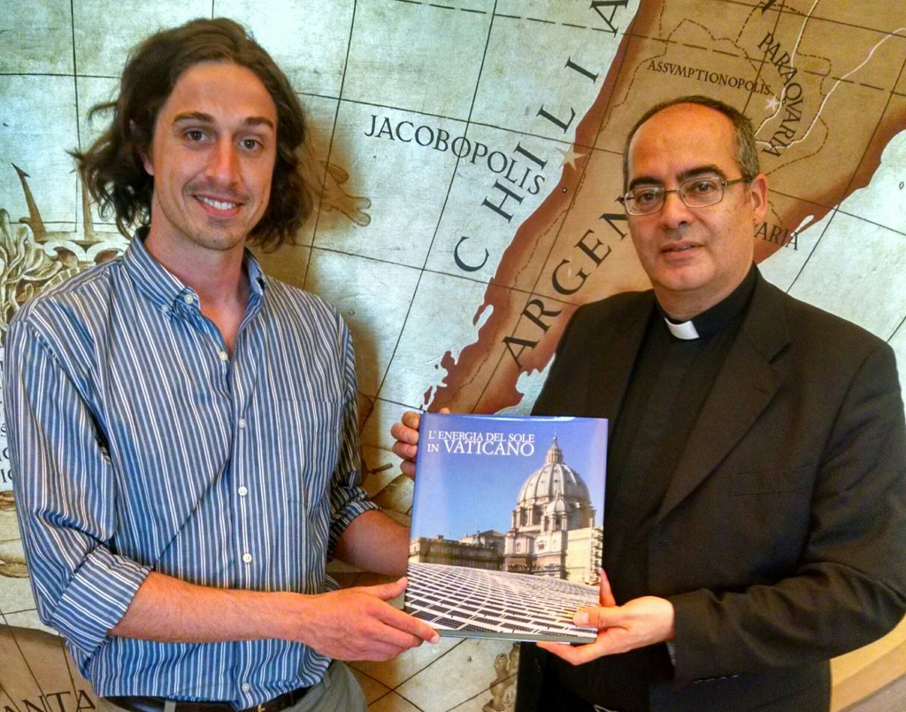 "Monsignor Karcher gives the book ""The Sun's Energy in the Vatican"" as a gift to GCCM on behalf of Pope Francis."