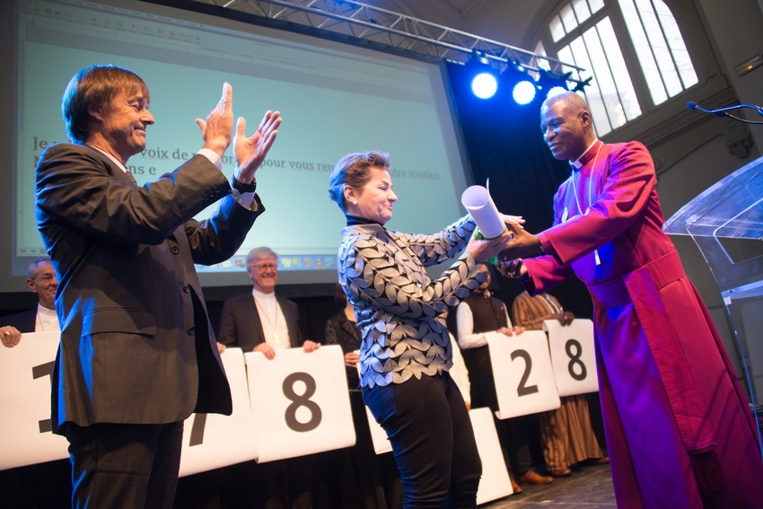 France's special envoy for the protection of the planet Nicolás Hulot (left) applauds as Archbishop Thabo Makgoba of South Africa presents Christiana Figueres, Executive Secretary of the United Nations Framework Convention on Climate Change, with some 1.8 million signatures on an interfaith petition for climate justice during the COP21 climate summit in Paris, France, November 28, 2015.